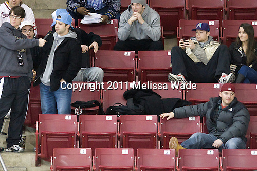 """Joe Whitney (BC - 15) takes part in a """"Name the Movie"""" contest as Barry Almeida (BC - 9), Jimmy Hayes (BC - 10), Edwin Shea (BC - 8), John Muse (BC - 1) and Lauren Wiedmeier look on. - The Boston College Eagles defeated the Harvard University Crimson 3-1 to win the 2011 Beanpot championship on Tuesday, February 15, 2011, at Conte Forum in Chestnut Hill, Massachusetts."""