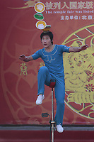 A Chinese acrobat performs on a unicycle at a temple fair to celebrate the Lunar New Year of the Tiger on February 15, 2010 in Beijing, China.