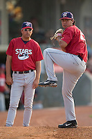Huntsville Stars starting pitcher Yovanni Gallardo warms-up under the watchful eye of pitching coach Rich Sauveur prior to taking on the Carolina Mudcats at Five County Stadium in Zebulon, NC, Thursday, July 20, 2006.