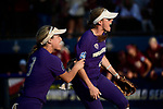 OKLAHOMA CITY, OK - JUNE 04: Taylor Van Zee #3 and Sis Bates #22 of the Washington Huskies celebrate after a big out against the Florida State Seminoles during the Division I Women's Softball Championship held at USA Softball Hall of Fame Stadium - OGE Energy Field on June 4, 2018 in Oklahoma City, Oklahoma. (Photo by Tim Nwachukwu/NCAA Photos via Getty Images)