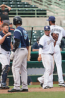 San Antonio Missions third baseman Diego Goris (15) smiles after winning the Texas League baseball game against the Corpus Christi Hooks on May 10, 2015 at Nelson Wolff Stadium in San Antonio, Texas. The Missions defeated the Hooks 6-5. (Andrew Woolley/Four Seam Images)