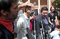 Protestors take over the Unite the Right rally organizer Jason Kessler press conference Sun., August 13, 2017 outside City Hall in Charlottesville, Va. The previous day, a woman was killed and several others injured after the Unite the Right rally, organized by Jason Kessler. Photo/Andrew Shurtleff