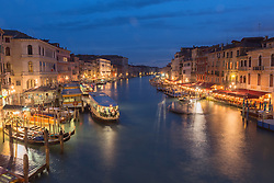 The busy Grande Canal shot from the Rialto bridge just after sunset, Venice.