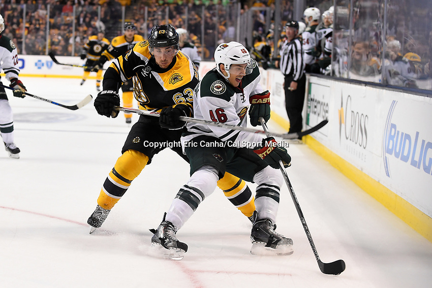 Thursday, November 19, 2015: Minnesota Wild defenseman Jared Spurgeon (46) works to keep the puck from Boston Bruins left wing Brad Marchand (63) during the National Hockey League game between the Minnesota Wild and the Boston Bruins held at TD Garden, in Boston, Massachusetts. Eric Canha/CSM