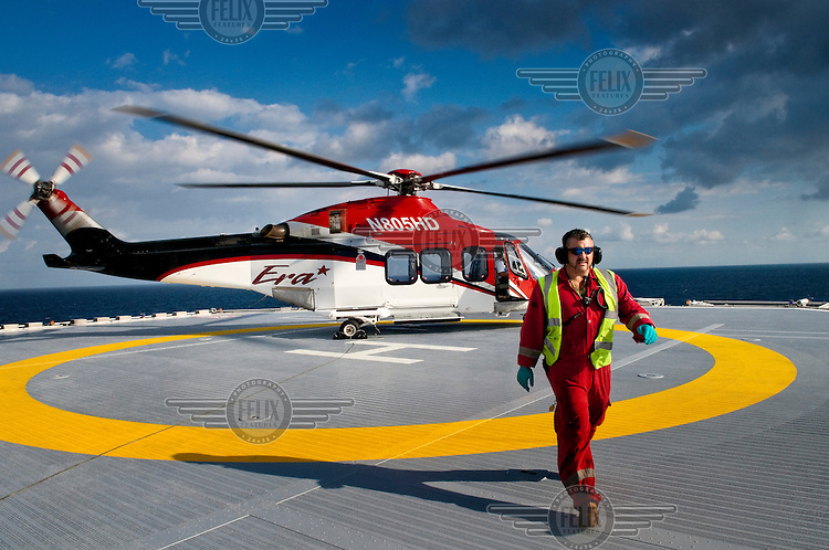 A helicopter lands on the helipad of the Stena drill boat that supports the Shenzi deepwater oil and gas platform in the Gulf of Mexico. BHP Billiton is the operator of the field with a 44 percent stake on behalf of the energy companies Repsol (28 percent) and Hess (28 percent).