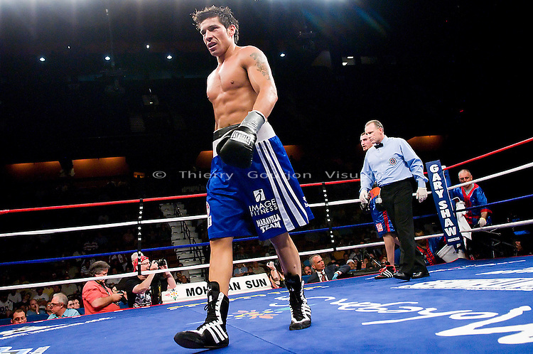 Uncasville, CT - June 7th, 2008: Sergio Martinez (blue/white trunk) walks back to his corner during his 8 rounds Super Welterweight fight against Archak Termeliksetian at the Mohegan Sun Casino. Martinez won by tko in the 7th round. Photo by Thierry Gourjon.