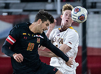 COLLEGE PARK, MD - NOVEMBER 21: Eli Crognale #10 of Maryland heads away from Josh Plimpton #7 of Iona during a game between Iona College and University of Maryland at Ludwig Field on November 21, 2019 in College Park, Maryland.