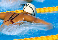 Rear view of a female swimmer in pool