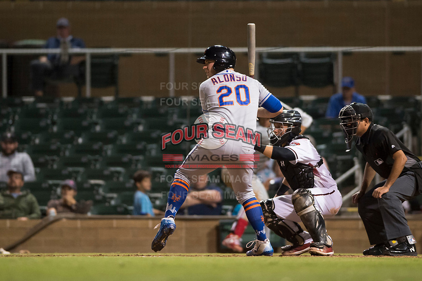 Scottsdale Scorpions designated hitter Peter Alonso (20), of the New York Mets organization, at bat in front of catcher Daulton Varsho (8) and home plate umpire Nestor Ceja during an Arizona Fall League game against the Salt River Rafters at Salt River Fields at Talking Stick on October 11, 2018 in Scottsdale, Arizona. Salt River defeated Scottsdale 7-6. (Zachary Lucy/Four Seam Images)