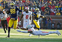Ohio State Buckeyes cornerback Bradley Roby (1) can't tackle Michigan Wolverines quarterback Devin Gardner (98) on a run  in the 4th quarter of their college football game at Michigan Stadium in Ann Arbor, Michigan on November 30, 2013.  (Dispatch photo by Kyle Robertson)