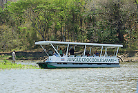 American crocodile, Crocodylus acutus.  A tour guide entertains tourists by feeding crocodiles on the Tarcoles River, Costa Rica