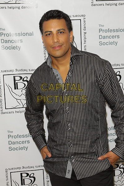 "NAPOLEON D'UMO.""The Professional Dancers Society Fall Ball"" held at The Sportsmen's Lodge, Studio City - California, USA..October 16th, 2009.half length black grey gray striped stripes shirt.CAP/ADM/TC.©T. Conrad/AdMedia/Capital Pictures."