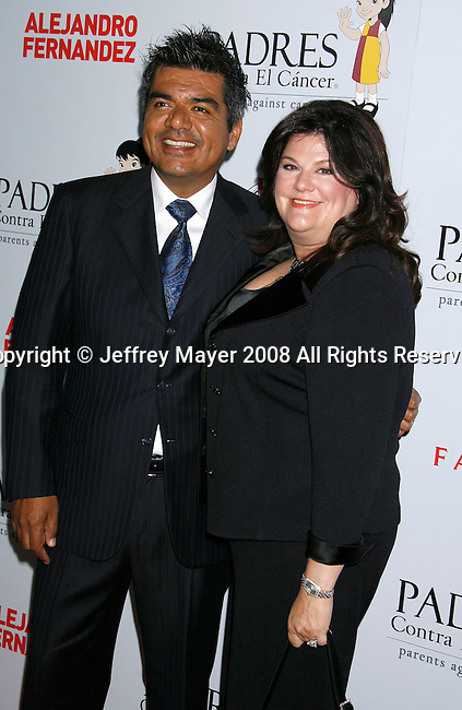 "HOLLYWOOD, CA. - October 07: Actor George Lopez and wife Ann Serrano arrive at the Padres Contra El Cancer's 8th Annual ""El Sueno De Esperanza"" Benefit Gala at the Hollywood & Highland Center on October 7, 2008 in Hollywood, California."