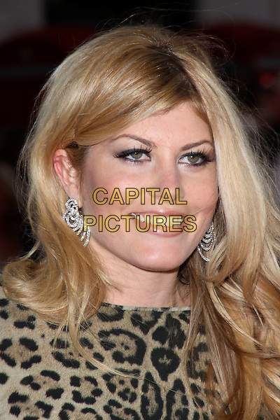 MEREDITH OSTROM.World Premiere of 'The Heavy' at the Odeon West End, Leicester Square, London, England, UK. .April 15th 2010 .headshot portrait make-up smiling earrings earrings brown leopard print animal .CAP/AH.©Adam Houghton/Capital Pictures.