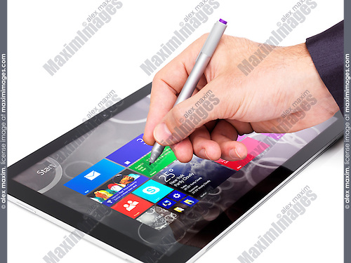 Person using Microsoft Surface Pro 3 tablet computer closeup of a hand with a pen isolated on white background
