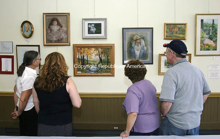 THOMASTON, CT 4/22/07- 042207BZ01-  People admire the work of local artists during a reception in the Lena Morton Art Gallery inside Town Hall in Thomaston Sunday.  The exhibit was hosted by The Fine Arts Connection of Thomaston.<br /> Jamison C. Bazinet Republican-American