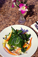 A presentation of lau lau, a Hawaiian meal of pork, chicken or fish and vegetables, in taro leaves, then wrapped in ti leaves