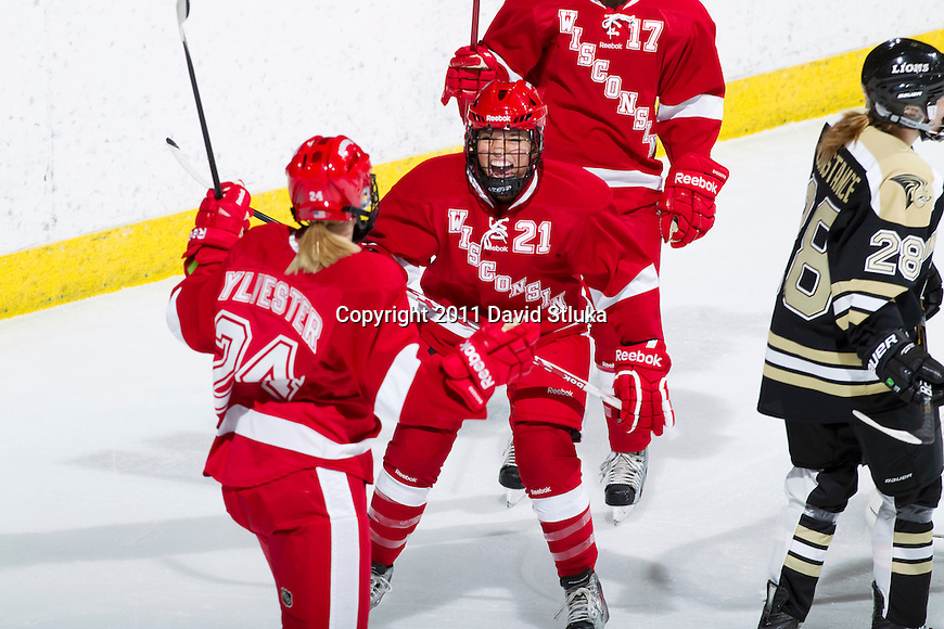 Wisconsin Badgers Lauren Unser (21) celebrates a goal during an NCAA Women's College Hockey game against Lindenwood University Lions on September 23, 2011 in Madison, Wisconsin. The Badgers won 11-0. (Photo by David Stluka)
