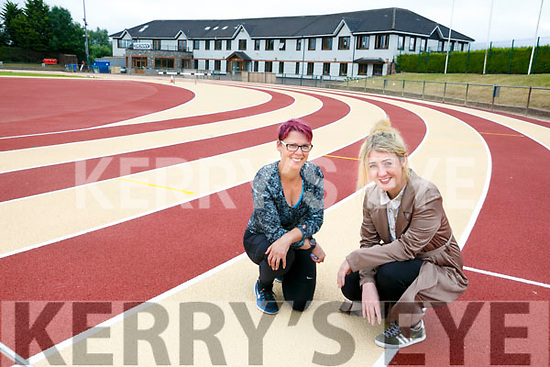 Tara Walmsley and Kate McSweeney, manager An Ríocht AC Castleisland inspecting the   refurbishment track surface