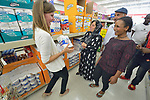 Penny Gushiken (left) leads a cultural orientation class for newly arrived refugees in Lancaster, Pennsylvania. During a visit to a supermarket, participants discuss available items, including toilet paper. The class is sponsored by Church World Service. <br /> <br /> Photo by Paul Jeffrey for Church World Service.