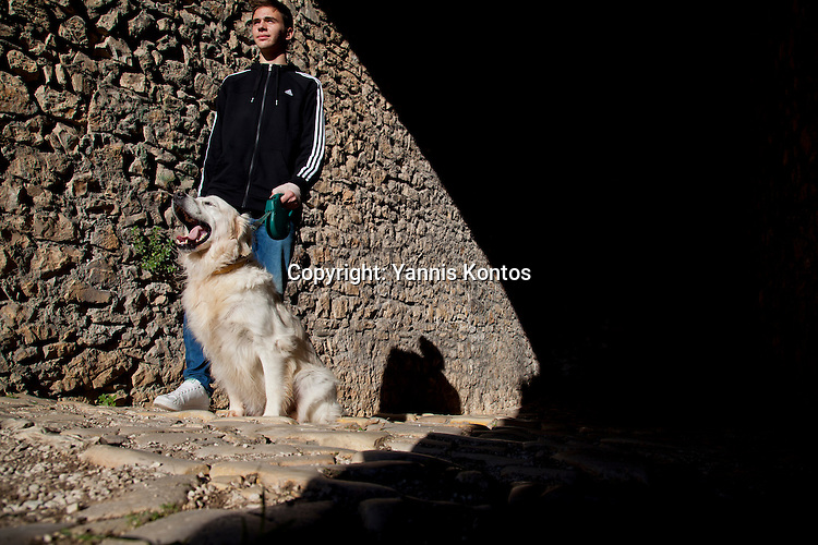 Greek student Konstantinos Vartziotis,18, with his dog near by the Ioannina lake.