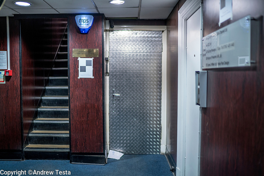 UK. London. 4th December 2015<br /> The boarded up entrance door to Hatton Garden Safe Deposit Ltd. <br /> Andrew Testa for the New York Times<br /> <br /> NOTE: No one stopped us from entering the building where these photos were taken, but whilst we were there someone came, threatened to call the police and said that we were forbidden to take photographs, not sure where that leaves us legally re publishing these photos.