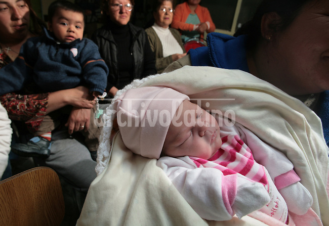 Mothers and their babies wait for atention at the hall of the Family Health Center Albert, in Cerro Navia, a suburb of Santiago, where doctors alert about the growing respiratory problems of the population as a result of the energy crisis of Chile.