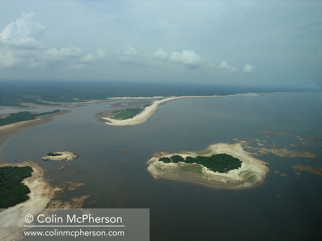 Arial photograph showing a section of the Amazon river inat record-low water levels. Many small towns and villages along the Amazon and Rio Negro rivers were cut off from river transport and faced food and drinking water shortages. Scientists have pinpointed climate change as a factor as the Amazon basin suffered its worst drought in 60 years with record-low rainfall recorded..