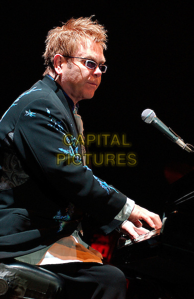 "SIR ELTON JOHN.performs as a part of his ""The Captain & The Kid Tour""  held at the Mellon Arena.  Pittsburgh, Pennsylvania, USA,.06 October 2006..concert music gig on stage live half length playing piano .Ref: ADM/JN.www.capitalpictures.com.sales@capitalpictures.com.©Jason L Nelson/AdMedia/Capital Pictures."