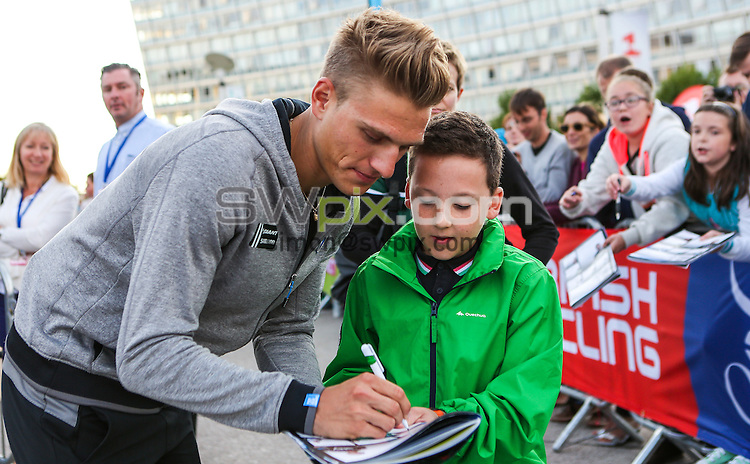Picture by Alex Whitehead/SWpix.com - 06/09/2014 - Cycling - 2014 Friends Life Tour of Britain- Team Presentation - Chavasse Park, Liverpool, England - Team Giant-Shimano's Marcel Kittel signs autographs for fans.