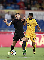 Calcio, Serie A: Roma, stadio Olimpico, 16 settembre 2017.<br /> Roma's Edin Dzeko (l) in action with Verona's Samuel Souprayen (r) during the Italian Serie A football match between AS Roma and Hellas Verona at Rome's Olympic stadium, September 16, 2017.<br /> UPDATE IMAGES PRESS/Isabella Bonotto