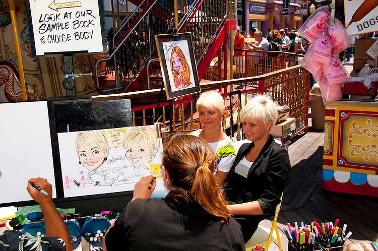 San Francisco: Caricaturist artist  at Pier 39.  Photo copyright Lee Foster. Photo # casanf104127