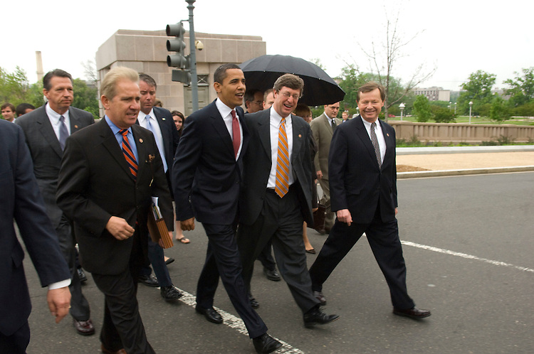 """WASHINGTON, DC - May 08: Democratic presidential hopeful Sen. Barack Obama, D-Ill., walks to the U.S. Capitol with House superdelegates after they emerged from a meeting at the UPS Townhouse, near the House side of Capitol Hill. With him are Rep. Tim Mahoney, D-Fla., Rep. Jim Costa, D-Calif., Rep. Ben Chandler, D-Ky., and Rep. Earl Pomeroy, D-N.D. Obama took his campaign for presidential superdelegate votes to the House floor once inside the Capitol, triggering complaints from some supporters of rival Sen. Hillary Rodham Clinton, D-N.Y. """"I have a question in my mind whether it's kosher, whether it's ethical. I don't think he should be doing this on the House floor. This is the first time I remember him being on our floor,"""" said Grace Napolitano, D-Calif., a staunch Clinton supporter. """"It's unusual. He's actively soliciting the votes of superdelegates on the floor,"""" said Alyson Schwartz, D-Pa., another Clinton backer. But other Democrats welcomed Obama's visit. """"Where else can you meet superdelegates? I don't have a problem with it,"""" said Majority Whip James E. Clyburn, D-S.C., who is uncommitted..(photo by Scott J. Ferrell/Congressional Quarterly)"""