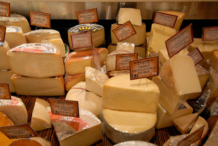 DiBruno Brothers cheese and gourmet food shop.  Cheeses on display..Philadelphia, Pennsylvania, PA USA.  Photo copyright Lee Foster, 510-549-2202, lee@fostertravel.com, www.fostertravel.com. Photo 323-30677.