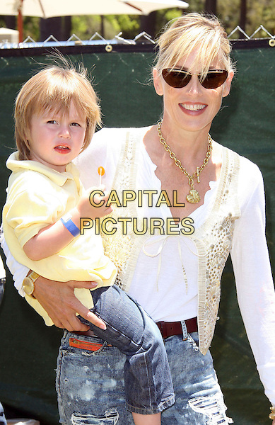 SHARON STONE & SON.Elizabeth Glaser Pediatric AIDS Foundation 20th Annual A Time For Heroes Celebrity Carnival held at Wadsworth Theater, Los Angeles, CA, USA, 6th June, 2009..half length carrying holding jeans ripped denim sunglasses white top cream beaded waistcoat baby Laird Vonne Stone.CAP/ADM/KB.©Kevan Brooks/Admedia/Capital Pictures