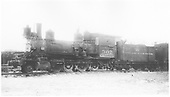 Fireman's-side view of D&amp;RGW locomotive #302 stored at Alamosa with cab boarded up, bell and main rod missing.<br /> D&amp;RGW  Alamosa, CO  1937-1939