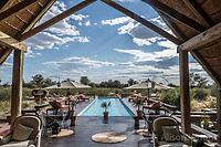 Africa, Botswana, Khwai, The Lodge, Feline Fields, edge of the Kalahari desert. Pool.