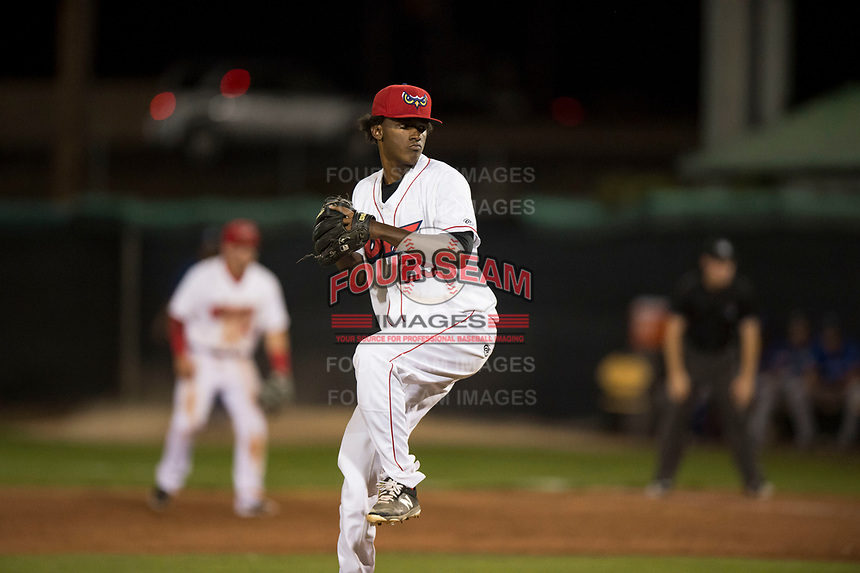 Orem Owlz relief pitcher Adalberto Pena (29) delivers a pitch during a Pioneer League game against the Ogden Raptors at Home of the OWLZ on August 24, 2018 in Orem, Utah. The Ogden Raptors defeated the Orem Owlz by a score of 13-5. (Zachary Lucy/Four Seam Images)
