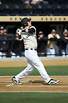 Bobby Seymour (3) of the Wake Forest Demon Deacons follows through on his swing against the Louisville Cardinals at David F. Couch Ballpark on March 18, 2018 in  Winston-Salem, North Carolina.  The Demon Deacons defeated the Cardinals 6-3.  (Brian Westerholt/Sports On Film)