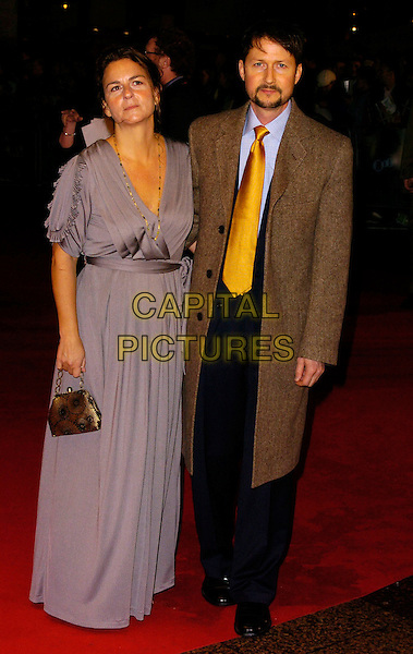 TODD FIELD & WIFE.The Times BFI London Film Festival: Little Children - gala screening, Odeon West End, London, UK. .October 25th, 2006 .Ref: CAN.full length purple dress brown coat husband wife.www.capitalpictures.com.sales@capitalpictures.com.©Can Nguyen/Capital Pictures.