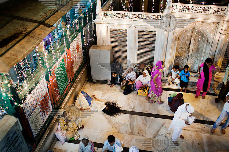 Muslims pray at Hazrat Nizamuddin's tomb.
