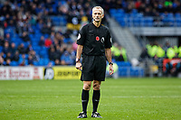 Referee Martin Atkinson stands on the pitch during the Premier League match between Cardiff City and Brighton & Hove Albion at the Cardiff City Stadium, Cardiff, Wales, UK. Saturday 10 November 2018