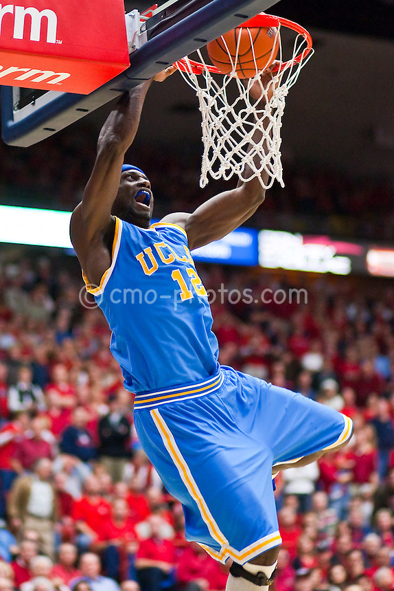 Feb 14, 2009; Tucson, AZ, USA; UCLA Bruins forward Alfred Aboya (12) dunks the ball in the first half of a game against the Arizona Wildcats at the McKale Center.