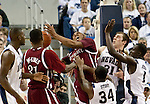 March 1, 2012: New Mexico State Aggies forward Tyrone Watson (center) fights against the Nevada Wolf Pack for a rebound during their NCAA basketball game played at Lawlor Events Center on Thursday night in Reno, Nevada.