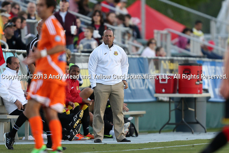 20 April 2013: Fort Lauderdale head coach Daryl Shore (in white) walks the sideline during the first half. The Carolina RailHawks played the Fort Lauderdale Strikers at WakeMed Stadium in Cary, North Carolina in a North American Soccer League Spring 2013 Season regular season game.