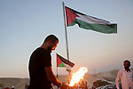 Palestinian protesters gather around the Palestinian flag at the Bedouin village of Khan al-Ahmar, in the occupied West Bank against Israel's plan to demolish the village on September 26, 2018. Photo by Shadi Hatem
