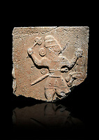 Hittite monumental relief sculpture of a man with an axe in one hand about to use it to kill a lion he is holding updide down in his other hand. Late Hittite Period - 900-700 BC. Adana Archaeology Museum, Turkey. Against a black background