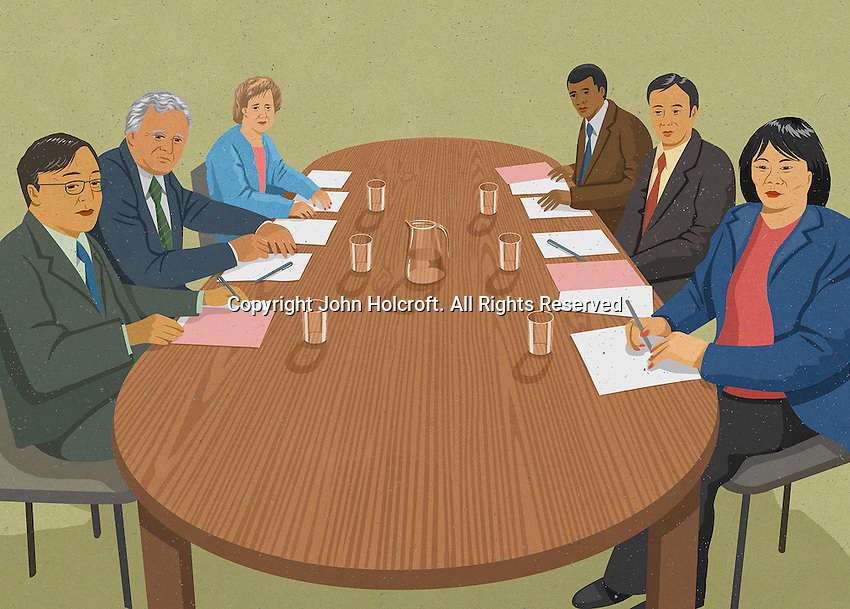Multicultural group of businesspeople sitting at boardroom table ExclusiveImage