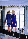 First lady Barbara Bush and Hillary Rodham Clinton, followed by the Bush family dog Millie, walk to the South Portico the White House in Washington, D.C. after their photo-op together following the election on November 19, 1992.  <br /> Credit: Howard L. Sachs / CNP