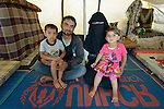 "Mamon Al-Hariri and his wife Huda, along with their children Morad, 4, and Hiba, 3, inside their tent in the Zaatari refugee camp near Mafraq, Jordan. The family fled fighting in Daraa, Syria, in 2013, crossing the border into Jordan without appropriate paperwork. They'd like to move elsewhere, but aren't permitted to leave the camp. <br /> <br /> ""There's a big difference between life here and how we lived back home,"" said the woman. ""We're happy with our neighbors here, but I spend my whole life sitting in a tent when back home I had a beautiful house and garden.""<br /> <br /> Established in 2012 as Syrian refugees poured across the border, the Zaatari camp held more than 80,000 refugees by 2015, and was rapidly evolving into a permanent settlement. ACT Alliance member agencies provide a variety of services to refugees living in the camp."